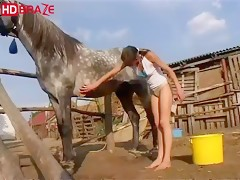 Brunette chick takes a big horse cock into her tight pussy