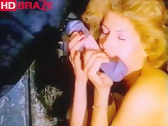 Blonde woman blowjobs horse cock in 1990