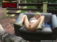 Blonde OutDoor With DOg On Chair