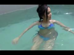 Busty Asian show her nice pussy at pool