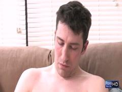Horny young gay caressing big cock by himself