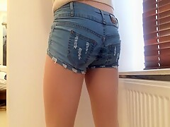 Cock in sheath pantyhose and denim shorts .